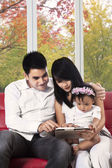 Attractive family with digital tablet at home — Stock Photo