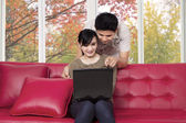 Couple choosing something on laptop — Stock Photo