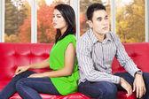 Couple quarreling and sitting separately — Stock Photo