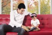Father and his child reading a book — Stock Photo