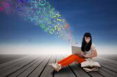 Female student studying with laptop — Stock Photo