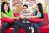 Friends fighting for remote tv — Stock Photo