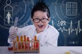 Funny scientist doing research in laboratory — ストック写真