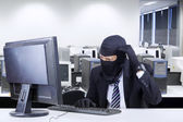Hacker in business suit getting confused — Stock Photo