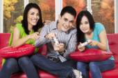 People playing game console at home — Stock Photo