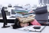 Secretary with paperwork on her head — Stock Photo