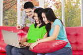 Three student looking at laptop computer — Stok fotoğraf