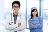 Two specialist doctors folded arms — Stock Photo