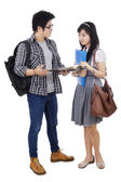 Two student discussing homework — Stock Photo