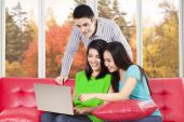 Two woman and boy using laptop — Stock Photo
