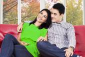 Woman and her boy sitting on sofa — Stock Photo