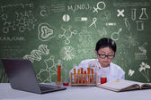 Young scientist with chemical fluid — Stock Photo