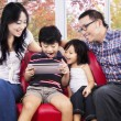Family sharing digital tablet for play — Stock Photo #53784631