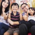 Hispanic family giving thumbs up — Stock Photo