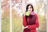Asian woman drinking hot cappuccino — Stock Photo