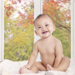 Beautiful baby girl smiling on bedroom — Stock Photo #54732009