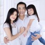 Happy hispanic family at home — Stock Photo #54735847