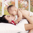 Happy mother kiss her baby girl — Stock Photo #54735917