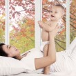 Playful mother with her baby on bedroom — Stock Photo #54738787