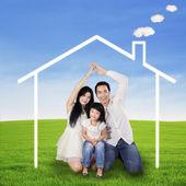 Hispanic family with dream house — Stock Photo