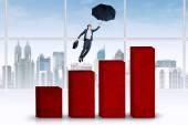 Hispanic woman flying over business chart — Stock Photo