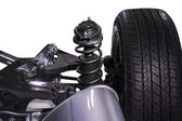 Wheel and shock absorber — Stock Photo