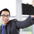 Businessman taking picture in office — Stock Photo #55332823
