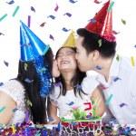 Joyful girl celebrate birthday with parents — Stock Photo #55334229