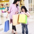Mother and daughter shopping at mall — Stock Photo #55334707