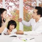 Sad girl with parents quarreling — Stock Photo #55335465