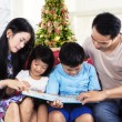 Two parents help their children to read — Stock Photo #55335995