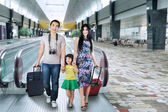 Asian tourist arrive in airport — Stock Photo