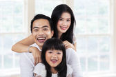 Cheerful family enjoy holiday at home — Stock Photo