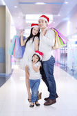 Cheerful family in the mall — Stock Photo