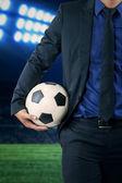 Futbol topu tutan girişimci — Stok fotoğraf