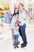 Portrait of happy family at mall — Stock fotografie