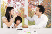Sad girl with parents quarreling — Stock Photo