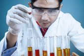 Scientist using reactants for experiment — Stock Photo