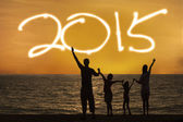 Silhouette of family enjoy new year — Stock Photo