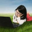 Cute girl with laptop on meadow — Stock Photo #55882237