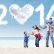 Happy family celebrate new year at beach — Stockfoto #55886009