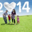 Happy family enjoying new year day — Stockfoto #55886325