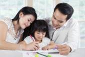Girl in homeschooling with their parents — Stock Photo
