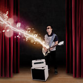 Guitarist perform on a stage — Stock Photo