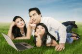 Happy family daydreaming outdoors — Stock Photo