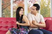 Hispanic couple quarreling on sofa — Stock Photo