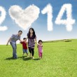 Young family enjoying new year day — Stock fotografie #55895209