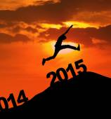 Silhouette man jumping over 2015 — Stock Photo