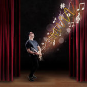 Talented guitarist perform on a stage — Stock Photo