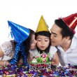 Sweet girl with her parents celebrate birthday — Stock Photo #56488391